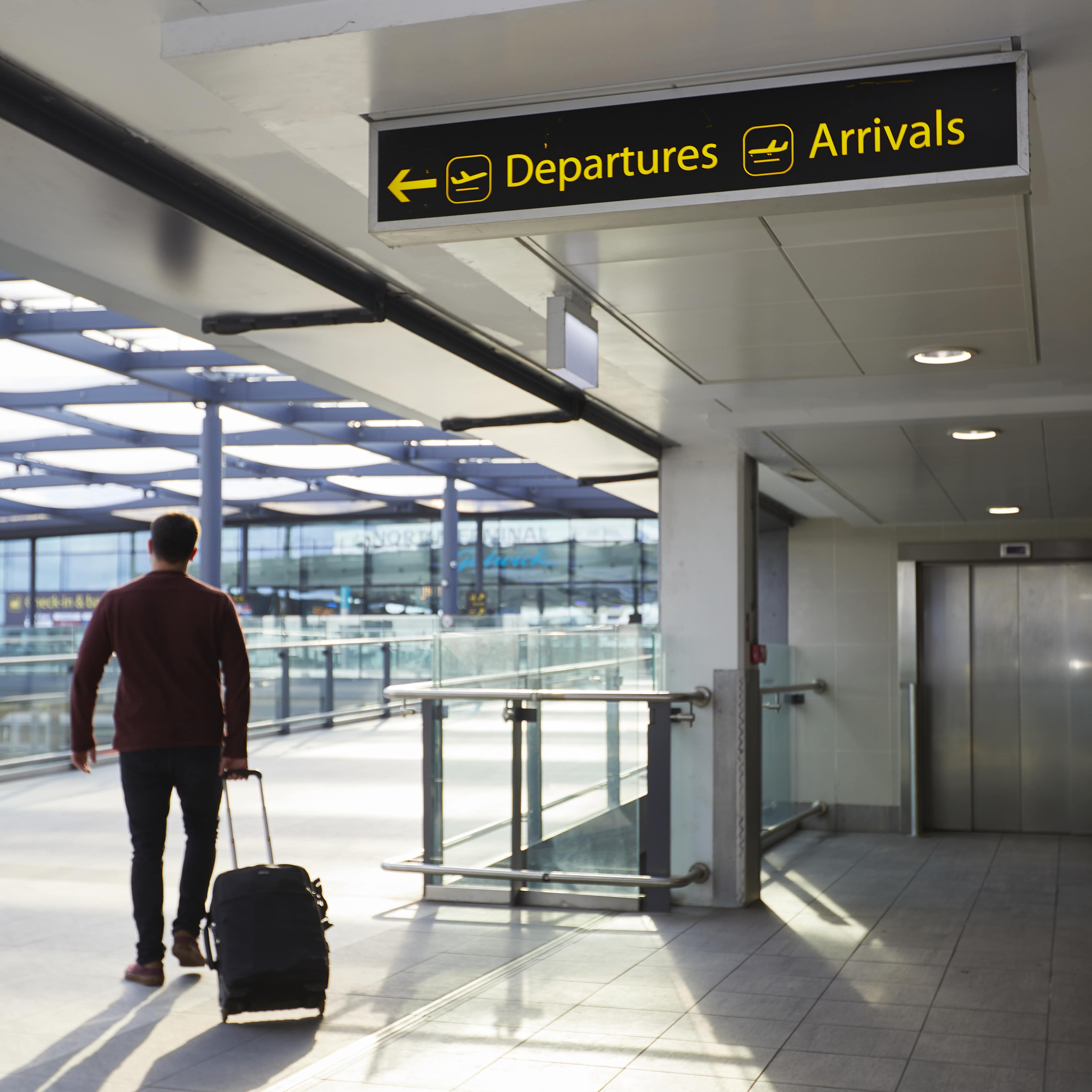 A man walks towards the North-Terminal having booked Gatwick Airport Official Parking