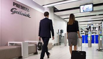 Two travellers passing through security having purchased Gatwick Airport Premium Security