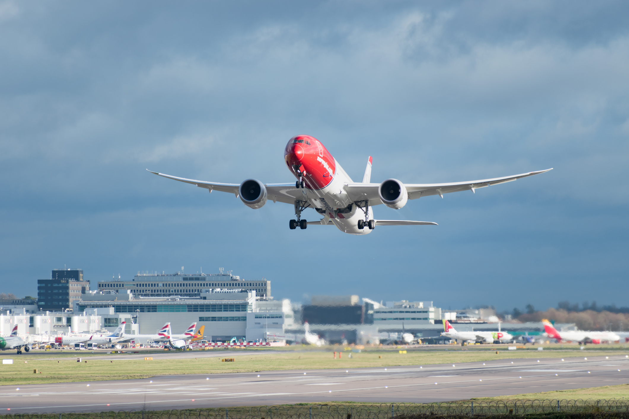 A Norwegian jet departing at Gatwick Airport