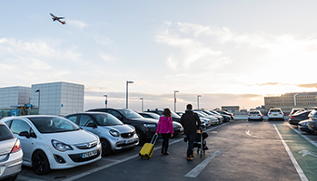 Two people make their way to the terminal building in Gatwick Airport's Short Stay car park