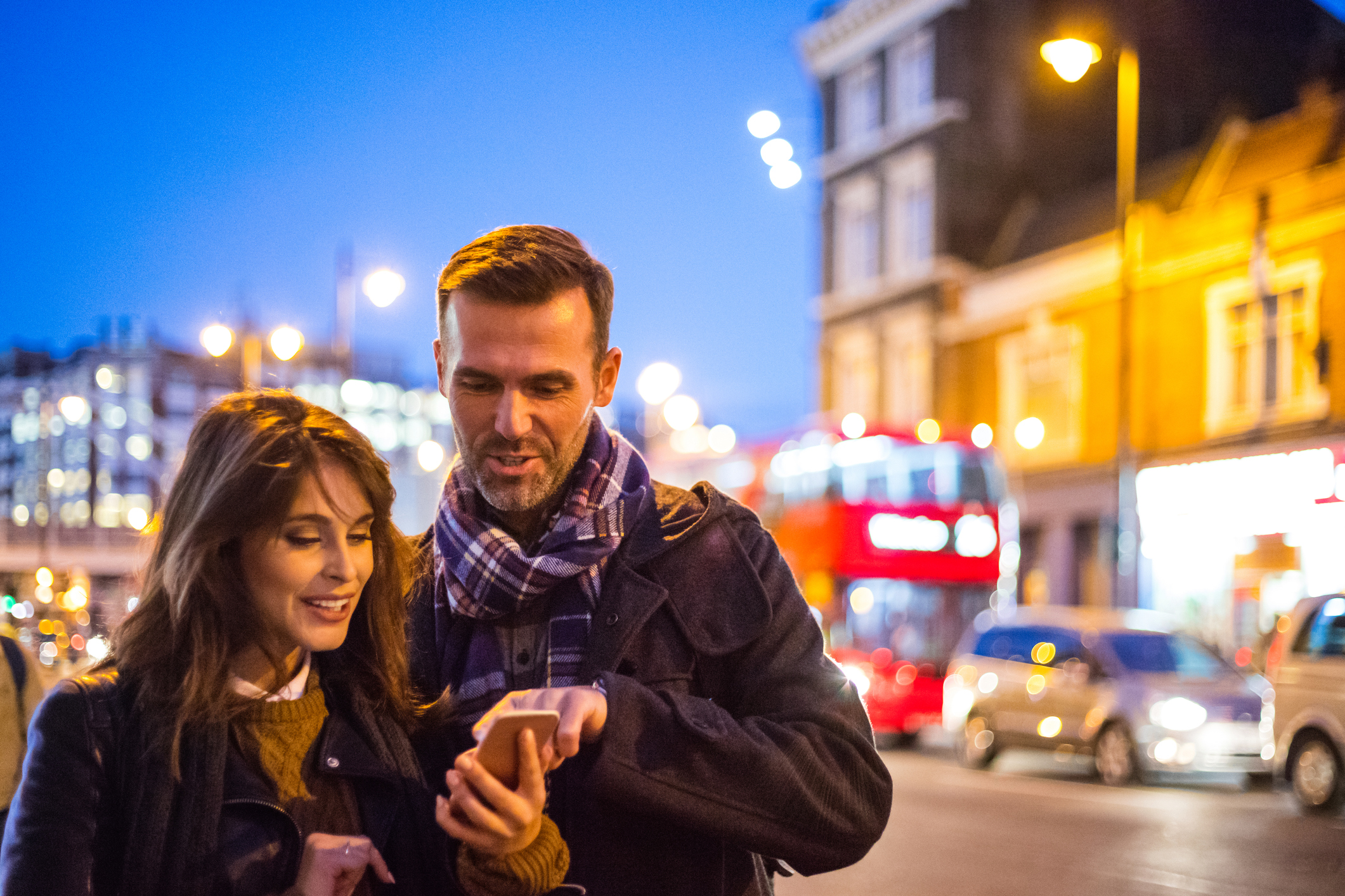 A couple enjoying a night out in London knowing their car is safely parked with Official Gatwick Airport Parking