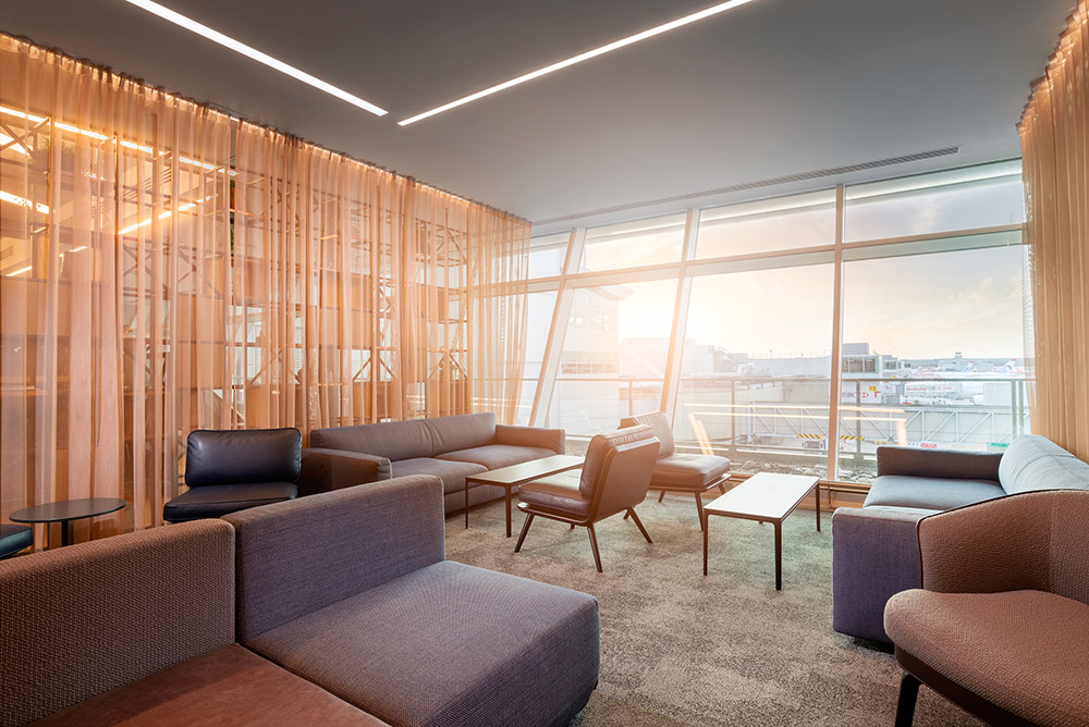 A bright and spacious seating area in Gatwick Airport's Club Aspire Lounge