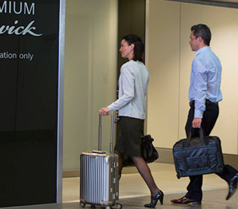 Two people breeze through Gatwick Airport Security having bought Premium Security for just £5 each
