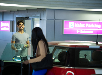 A young couple dropping their car off at Gatwick Airport's Meet and Greet area
