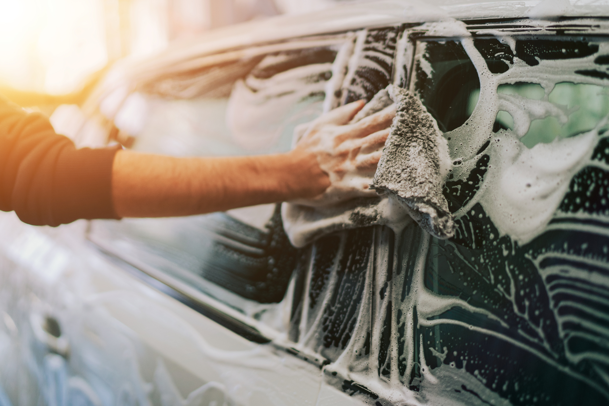 Someone hand washing a car for a customer with Gatwick Airport's Premium Car Care